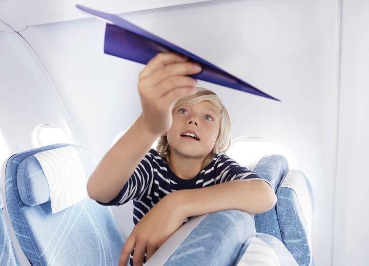 Finnair economy boy with paper plane 01 Low
